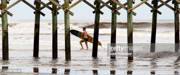 Mike Martin rides the waves at Folly Beach September 13 2018 in Charleston South Carolina United States Coastal cities in North Carolina South...