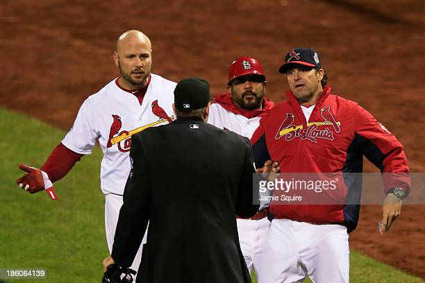 Mike Matheny of the St Louis Cardinals argues a call with home plate umpire Paul Emmel against the Boston Red Sox during Game Four of the 2013 World...