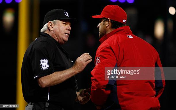 Mike Matheny of the St Louis Cardinals argues with home plate umpire Brian Gorman after a run scored on a throwing error in the sixth inning by...
