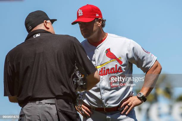 Mike Matheny of the St Louis Cardinals talks to umpire Brian O'Nora after making a pitching change during the third inning against the San Francisco...