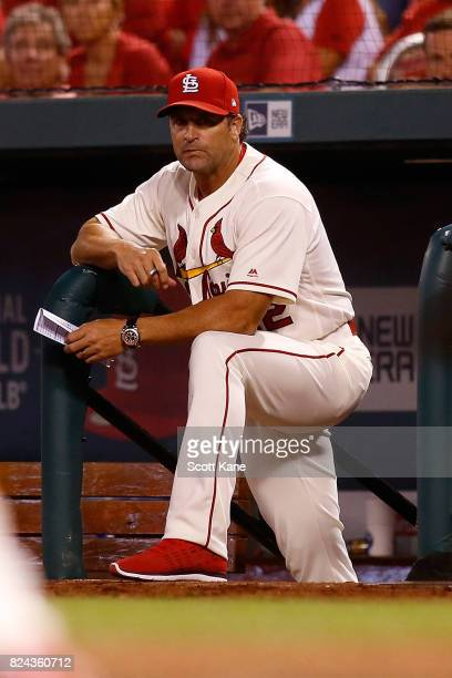 Mike Matheny of the St Louis Cardinals watches the game from the steps of the dugout during the seventh inning against the Arizona Diamondbacks at...