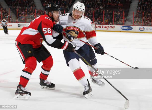 Mike Matheson of the Florida Panthers fights off Magnus Paajarvi of the Ottawa Senators at Canadian Tire Centre on March 29 2018 in Ottawa Ontario...