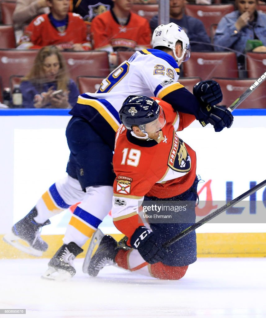 Mike Matheson #19 of the Florida Panthers is tripped by Vince Dunn #29 of the St. Louis Blues during a game at BB&T Center on October 12, 2017 in Sunrise, Florida.