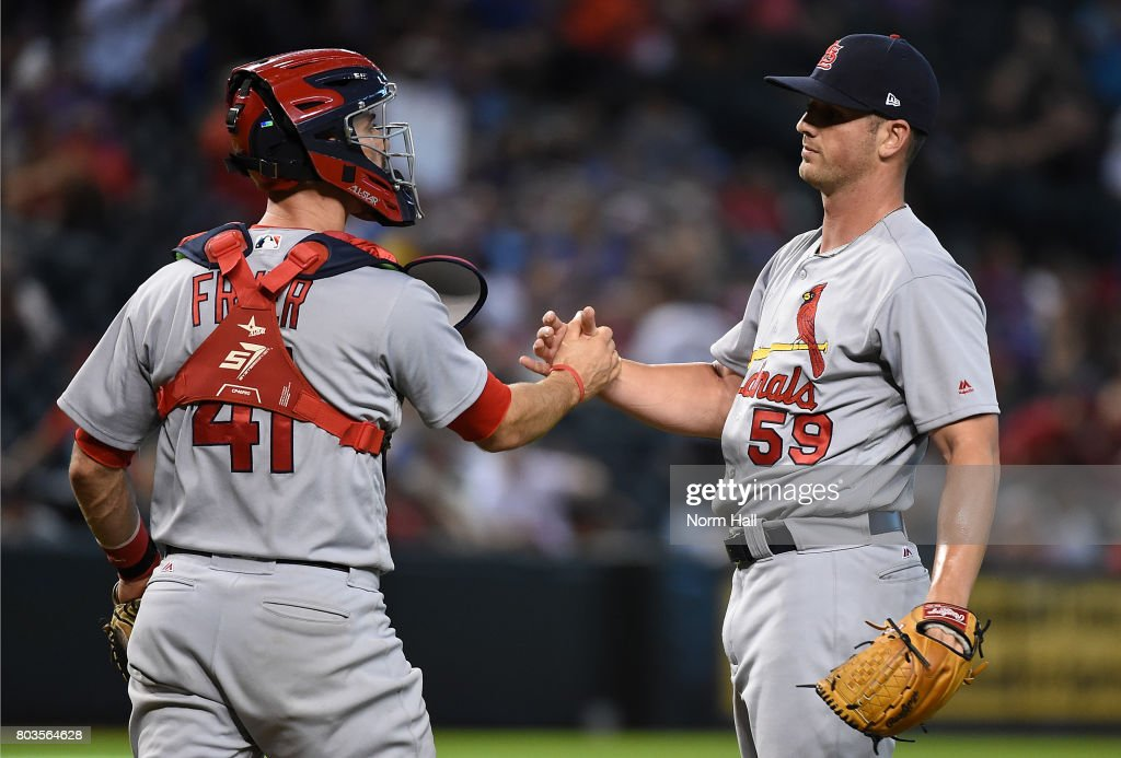 Mike Mayers #59 and Eric Fryer #41 of the St Louis Cardinals celebrate a 10-4 win against the Arizona Diamondbacks at Chase Field on June 29, 2017 in Phoenix, Arizona.
