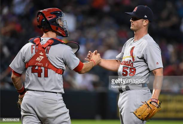 Mike Mayers and Eric Fryer of the St Louis Cardinals celebrate a 104 win against the Arizona Diamondbacks at Chase Field on June 29 2017 in Phoenix...