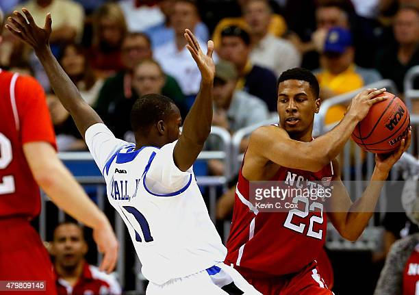 Mike McCall Jr #11 of the Saint Louis Billikens defends Ralston Turner of the North Carolina State Wolfpack in the second half during the second...