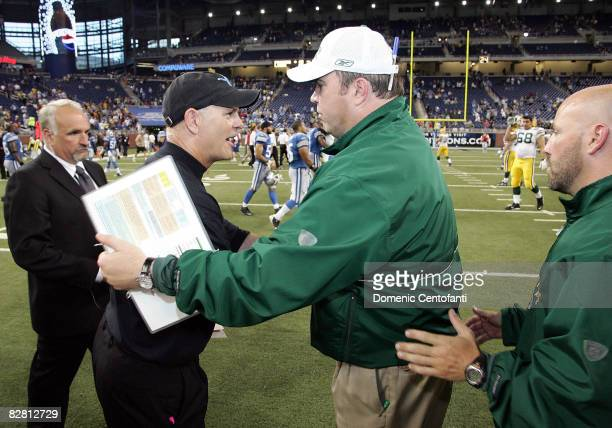 Mike McCarthy, head coach of the Green Bay Packers, shakes hands at mid-field with head coach of the Detroit Lions, Rod Marinelli on September 14,...
