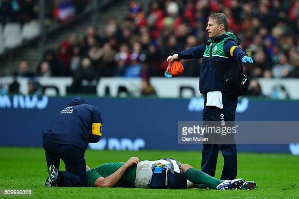 Mike McCarthy of Ireland receives medical treatment during the RBS Six Nations match between France and Ireland at the Stade de France on February 13...