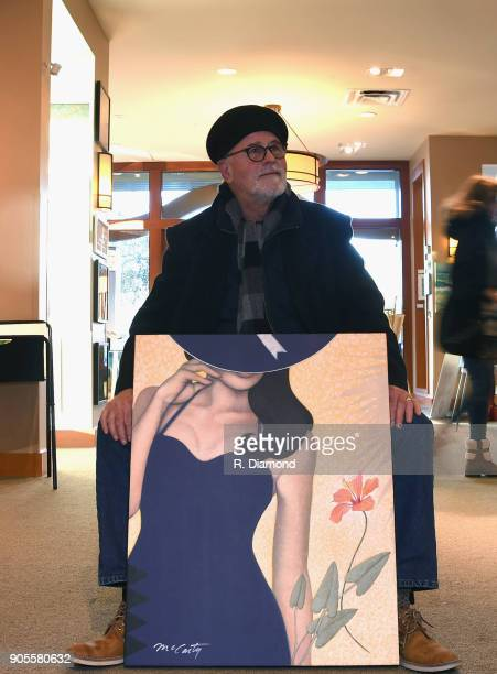 Mike McCarty displays painting from his collection of paintings at The Foster Gallery during the 9th Annual 30A Songwriters Festival day 2 on January...
