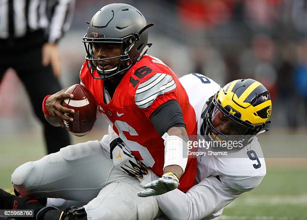 Mike McCray of the Michigan Wolverines sacks JT Barrett of the Ohio State Buckeyes during the second half of their game at Ohio Stadium on November...