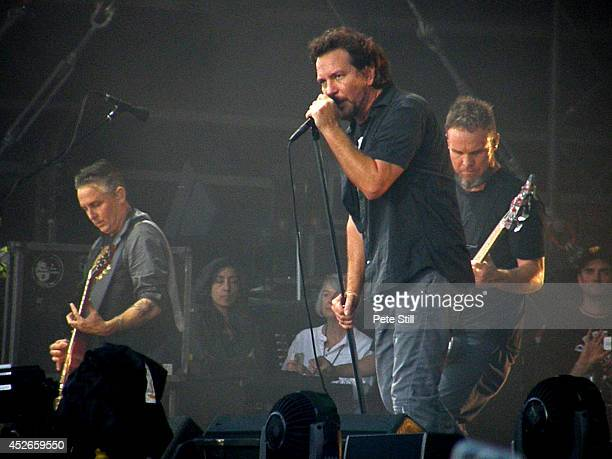 Mike McCready Eddie Vedder and Jeff Ament of Pearl Jam perform on stage at Milton Keynes Bowl on July 11 2014 in Milton Keynes United Kingdom