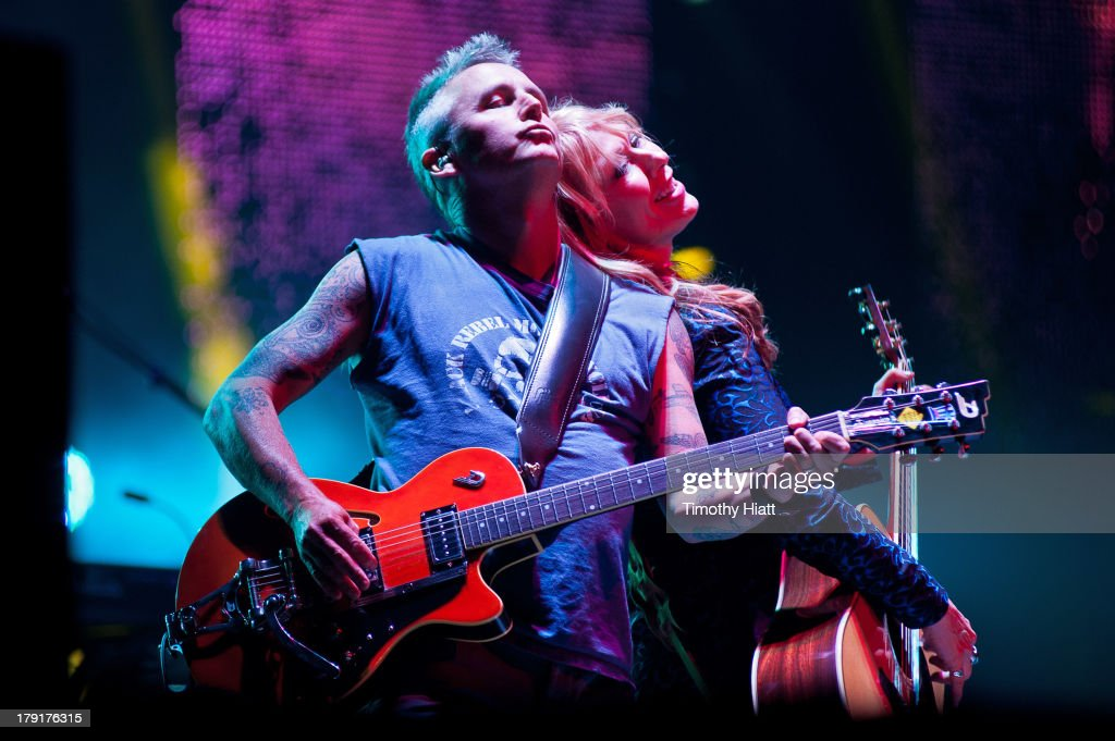 Mike McCready of Pearl Jam and Nancy Wilson of Heart perform during the Bumbershoot Music Festival at Seattle Center on August 31, 2013 in Seattle, Washington.