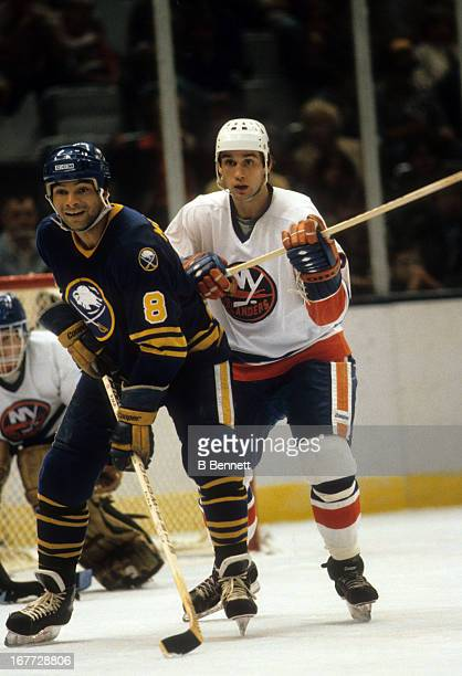 Mike McEwen of the New York Islanders defends against Tony McKegney of the Buffalo Sabres on November 7 1981 at the Nassau Coliseum in Uniondale New...