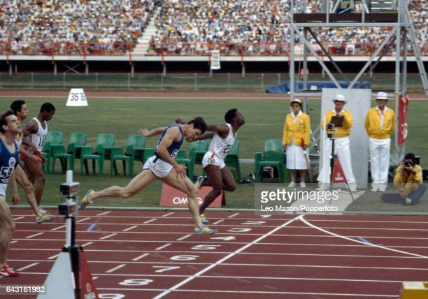 Mike McFarlane of England and Allan Wells of Scotland achieve a dead heat in the final of the men's 200 metres event during the Commonwealth Games in...
