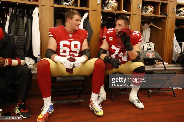 Mike McGlinchey and Joe Staley of the San Francisco 49ers talk in the locker room prior to the game against the Seattle Seahawks at Levi's Stadium on...