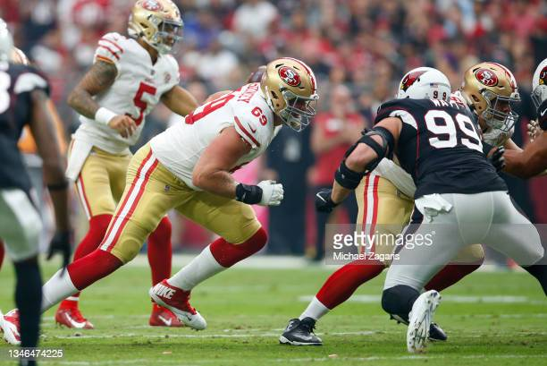 Mike McGlinchey of the San Francisco 49ers goes to block during the game against the Arizona Cardinals at State Farm Stadium on October 10, 2021 in...