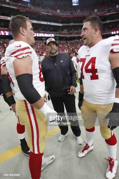 Mike McGlinchey Offensive Line Coach John Benton and Joe Staley of the San Francisco 49ers talk on the sideline prior to the game against the Arizona...