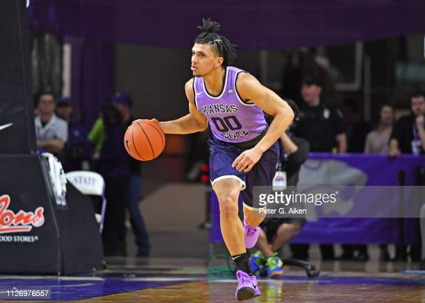 Mike McGuirl of the Kansas State Wildcats brings the ball out court during the second half against the Oklahoma State Cowboys on February 23 2019 at...