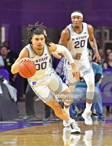Mike McGuirl of the Kansas State Wildcats dribbles the ball up court against the Iowa State Cyclones during the second half at Bramlage Coliseum on...