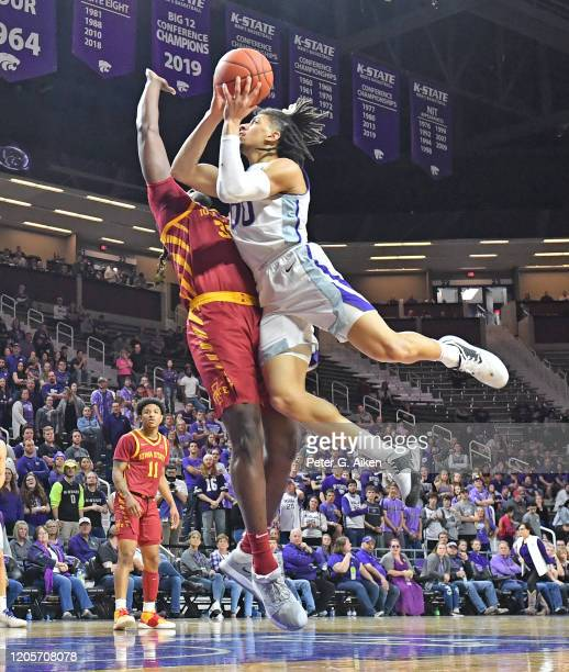Mike McGuirl of the Kansas State Wildcats drives and scores a basket against Solomon Young of the Iowa State Cyclones during the second half at...