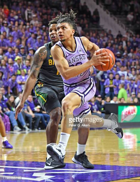 Mike McGuirl of the Kansas State Wildcats drives to the basket against Mark Vital of the Baylor Bears during the second half at Bramlage Coliseum on...