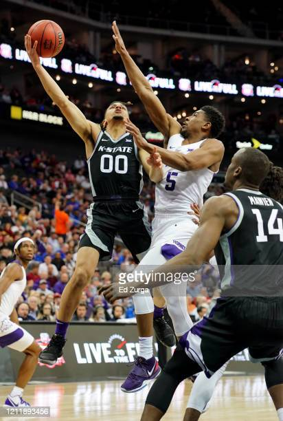 Mike McGuirl of the Kansas State Wildcats lays the ball up against Jaire Grayer of the TCU Horned Frogs in the first half during the first round of...