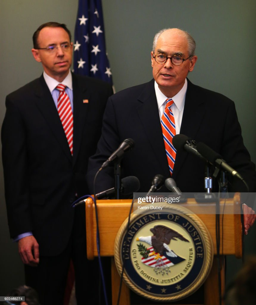 Mike McKay, National Association of Former U.S. Attorneys, with U.S. Deputy Attorney General Rod Rosenstein behind him, speaks at a press conference on the investigation into the murder of federal prosecutor Tom Wales at the U.S. Attorney's Office Western District of Washington on February 21, 2018 in Seattle, Washington.