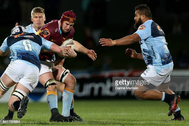 Mike McKee of Southland is tackled by Murray Douglas of Northland during the round three Mitre 10 Cup match between Southland and Northland at Rugby...