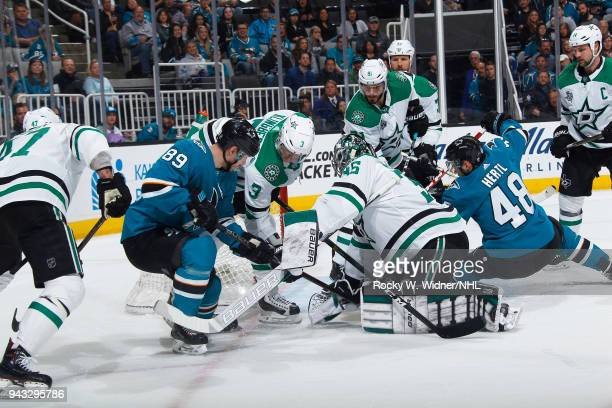 Mike McKenna and John Klingberg of the Dallas Stars defend the net against Logan Couture and Tomas Hertl of the San Jose Sharks at SAP Center on...