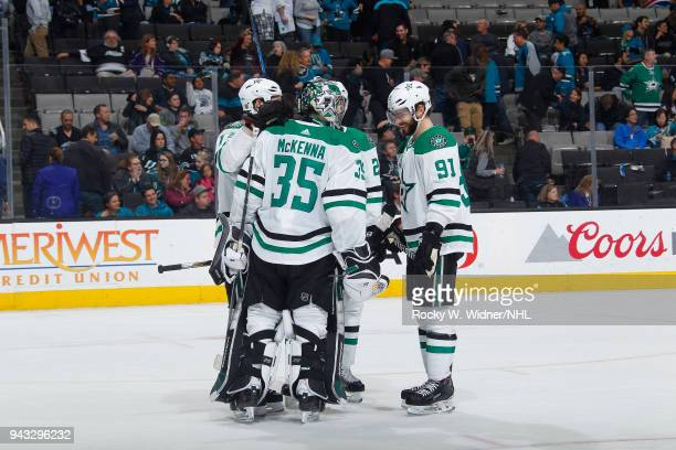 Mike McKenna and Tyler Seguin of the Dallas Stars celebrate with teammates after defeating the San Jose Sharks at SAP Center on April 3 2018 in San...