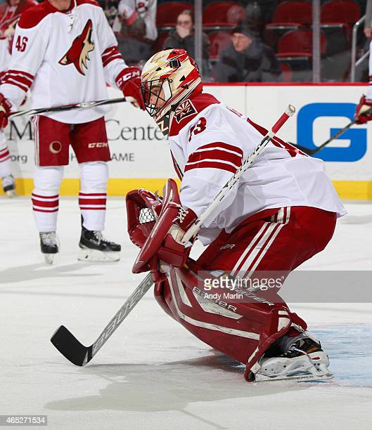 Mike McKenna of the Arizona Coyotes defends the net during pregame warmups prior to the game against the New Jersey Devils at the Prudential Center...