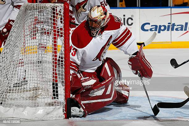 Mike McKenna of the Arizona Coyotes skates during warmsups prior to the game against the New York Islanders at Nassau Veterans Memorial Coliseum on...