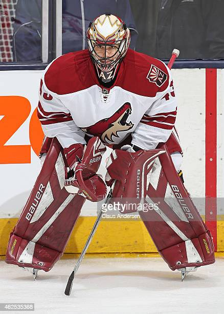 Mike McKenna of the Arizona Coyotes waits to face shots in the warmup prior to play against the Toronto Maple Leafs during an NHL game at the Air...
