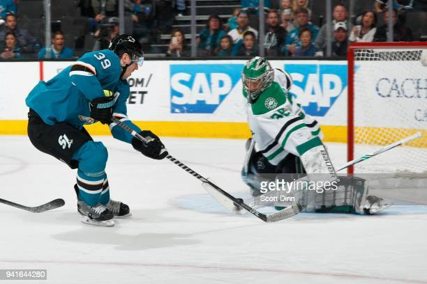 Mike McKenna of the Dallas Stars makes a stick save against Logan Couture of the San Jose Sharks at SAP Center on April 3 2018 in San Jose California