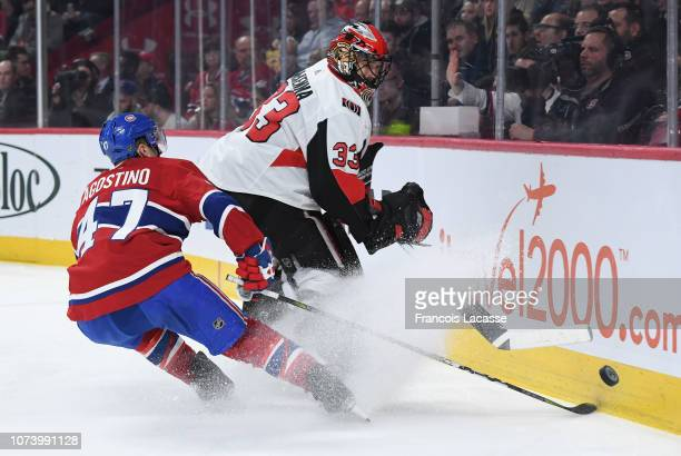 Mike McKenna of the Ottawa Senators clears the puck while being challenged by Kenny Agostino of the Montreal Canadiens in the NHL game at the Bell...