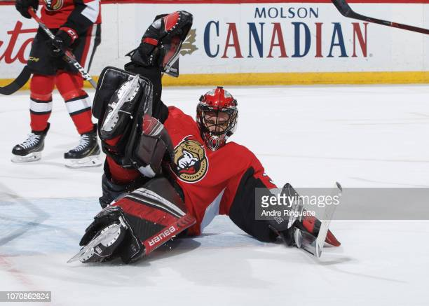 Mike McKenna of the Ottawa Senators stacks the pads to make a save in overtime against the Boston Bruins at Canadian Tire Centre on December 9 2018...
