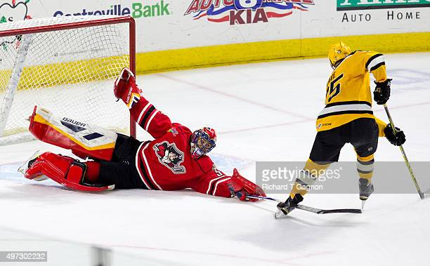 Mike McKenna of the Portland Pirates makes a gamewinning sprawling save against Colby Cave of the Providence Bruins during the final round of a...