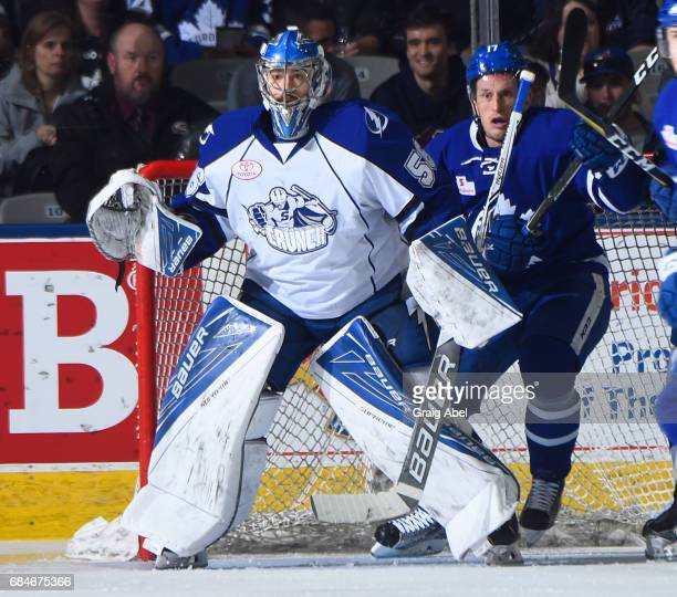 Mike McKenna of the Syracuse Crunch and Rich Clune of the Toronto Marlies prepare for a shot during game 6 action in the Division Final of the Calder...