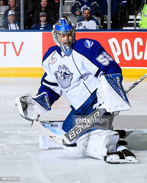 Mike McKenna of the Syracuse Crunch stops a shot against the Toronto Marlies during game 3 action in the Division Final of the Calder Cup Playoffs on...