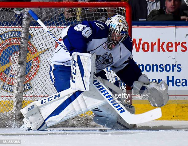 Mike McKenna of the Syracuse Crunch stops a shot against the Toronto Marlies during game 4 action in the Division Final of the Calder Cup Playoffs on...