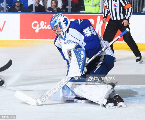 Mike McKenna of the Syracuse Crunch stops a shot against the Toronto Marlies during game 6 action in the Division Final of the Calder Cup Playoffs on...