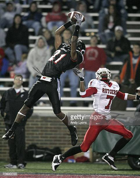 Mike Mickens of the Cincinnati Bearcats intercepts a pass in the end zone over Tiquan Underwood of the Rutgers Scarlet Knights during the game on...