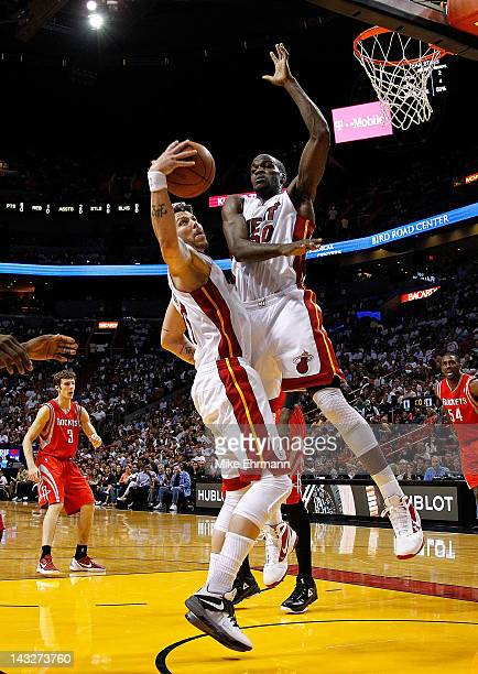 Mike Miller and Joel Anthony of the Miami Heat fight for a rebound during a game against the Houston Rockets at American Airlines Arena on April 22...