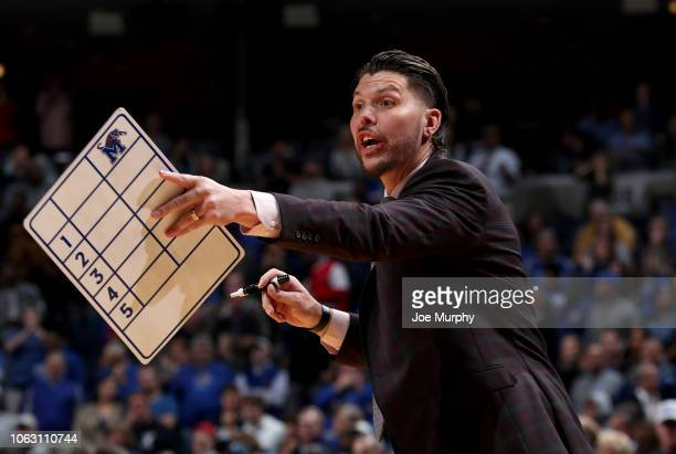 Mike Miller assistant coach of the Memphis Tigers points from the sideline against the Yale Bulldogs on November 17 2018 at FedExForum in Memphis...