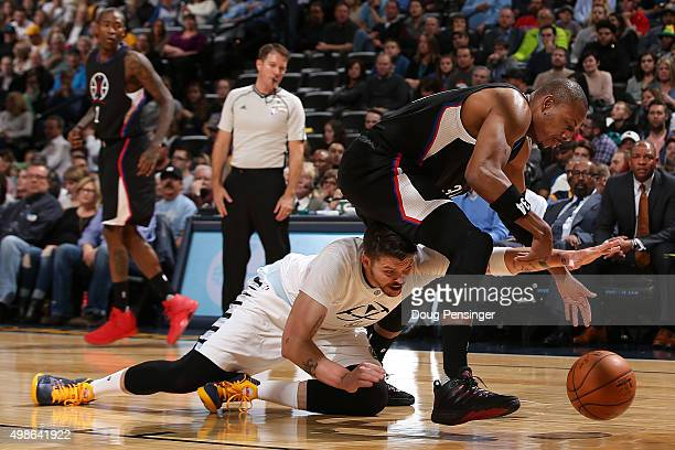 Mike Miller of the Denver Nuggets is called for a foul as he battles for a lose ball against Paul Pierce of the Los Angeles Clippers at Pepsi Center...