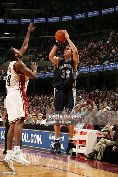 Mike Miller of the Memphis Grizzlies attempts a shot against Damon Jones of the Cleveland Cavaliers November 11, 2005 at Quicken Loans Arena in...