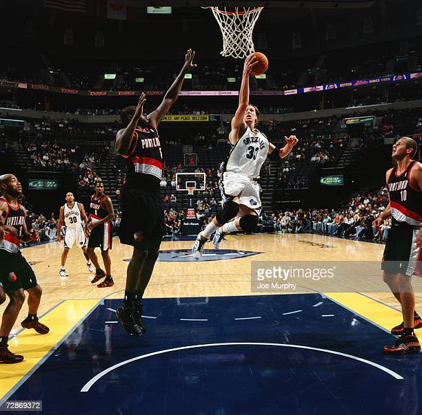Mike Miller of the Memphis Grizzlies drives to the basket for a layup against Zach Randolph of the Portland Trail Blazers at the FedExForum on...
