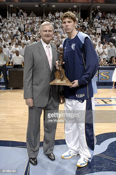 Mike Miller of the Memphis Grizzlies is presented with the 6th Man Award by Jerry West Memphis Grizzlies President of Basketball Operations in game...