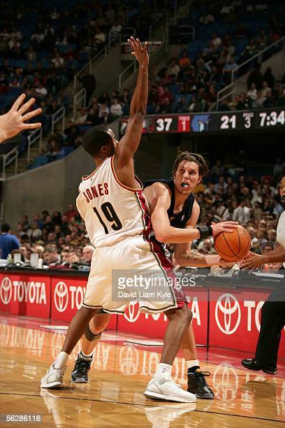 Mike Miller of the Memphis Grizzlies looks to pass against Damon Jones of the Cleveland Cavaliers November 11, 2005 at Quicken Loans Arena in...