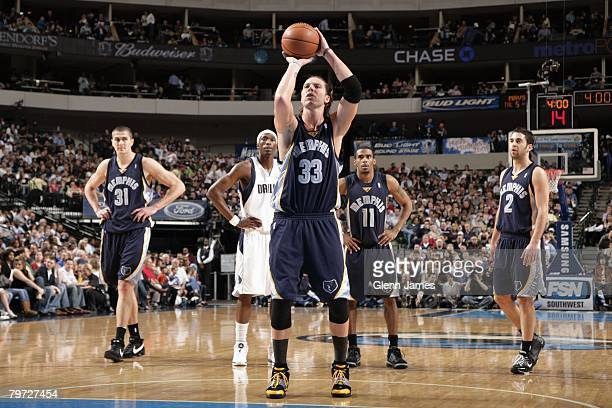 Mike Miller of the Memphis Grizzlies shoots a free throw during the game against the Dallas Mavericks at the American Airlines Center on February 8...